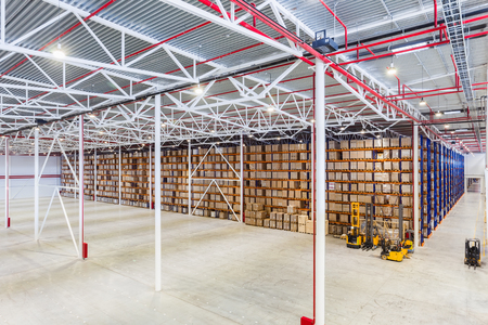 Photo for New Large modern storehouse with some goods - Royalty Free Image