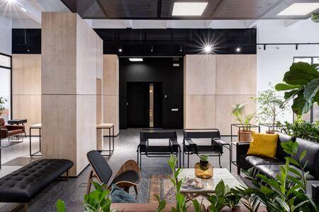 Foto de modern open space office interior with furniture - Imagen libre de derechos