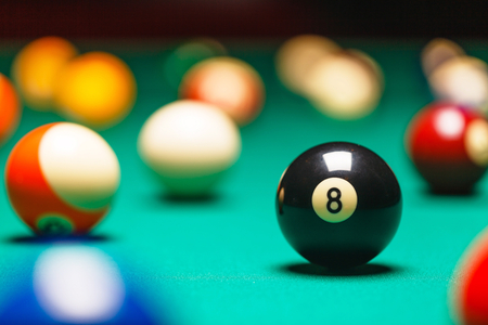 Photo pour Billiard balls / A Vintage style photo from a billiard balls in a pool table. Noise added for a film effect - image libre de droit