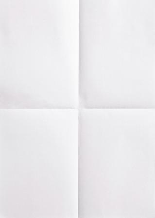 Foto de white sheet of paper folded in four - Imagen libre de derechos