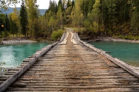 Old wooden bridge over river Belaya Berel in eastern Kazakhstan