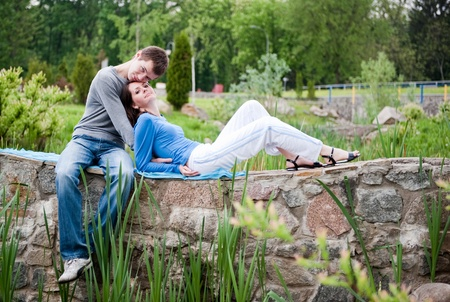 Young couple dating in a spring park