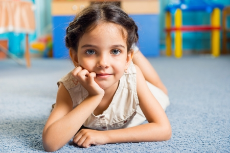 Beautiful little latin girl portrait in daycare