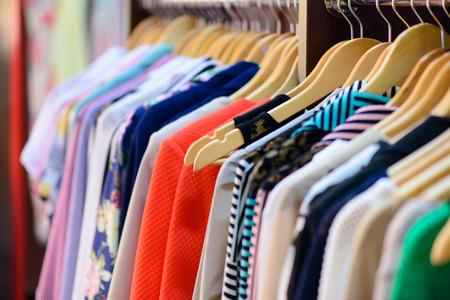 Foto de Variety of clothes hanging on rack in boutique - Imagen libre de derechos
