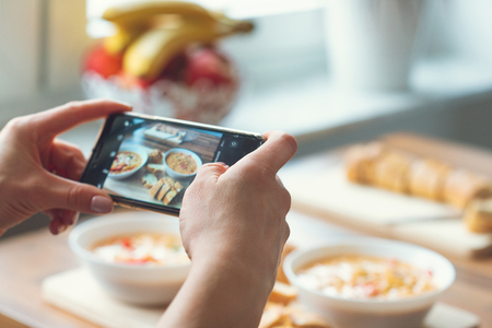 Photo for Closeup how womans hands taking photo of vegetarian food at home - Royalty Free Image