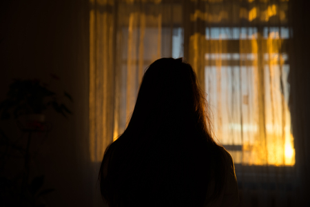 woman silhouette in front of window. sunrise in window. Wake up in morning