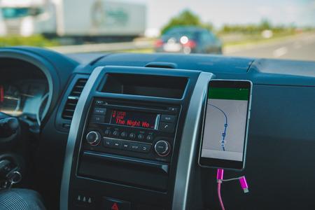 Foto de car dashboard with phone navigation. car travel - Imagen libre de derechos