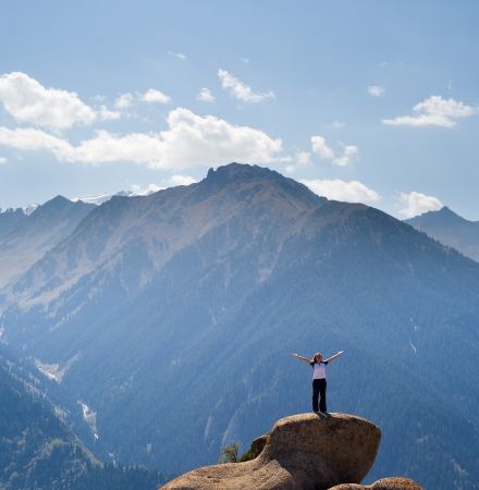 Photo for Yoga at summit with aerial view of the mountain range - Royalty Free Image