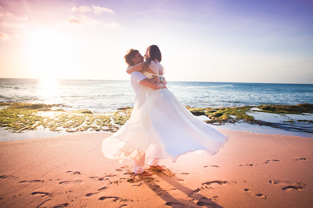 wedding couple just married at the beach