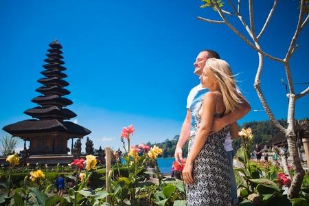 Honeymoon couple near the Balinese temple at beratan lake, Bali