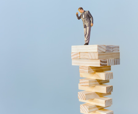 risk manager standing on the top and looking down, with copy space for any text