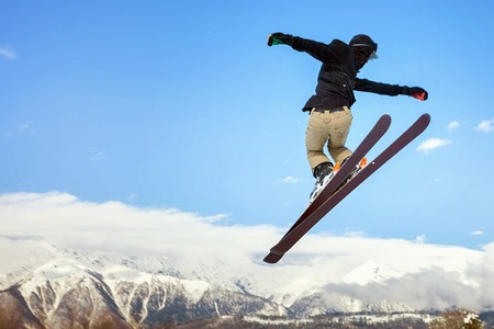 Skier doing high jump above the mountain at Switzerland alps. Swiss. Freestyle. Winter sport. Healthy lifestyle
