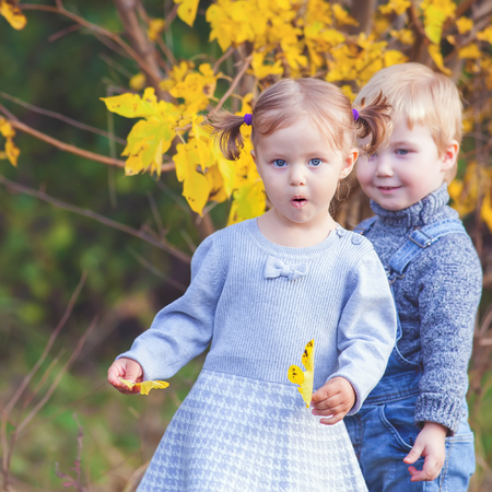 Fashion kids outdoor at fall season. Has a date. Happy Family Values. Baby boy and girl. Children care. International Children\'s Day at 20 November or June 1 Universal Children\'s Day