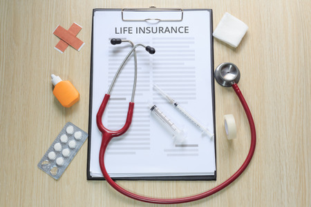 Photo pour Top view of life insurance policy with stethoscope, hypodermic syringe, plaster, gauze, tincture and tape. - image libre de droit