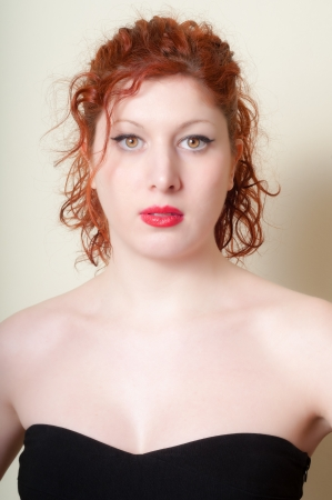 beautiful red hair and lips girl on white background