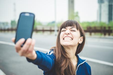 beautiful woman selfie in a desolate lurban landscape