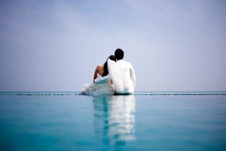 Foto de In love bride and groom are posing in romantic emotion - Imagen libre de derechos