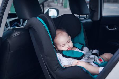 Photo pour The toddler Asian boy is sleeping at his car seat.Focus on face - image libre de droit