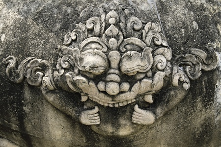 Stone giant head thai style  in chet yot temple, Chiang Mai Thailand.