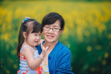 Photo for Happy grandma carrying grandchildren - Royalty Free Image