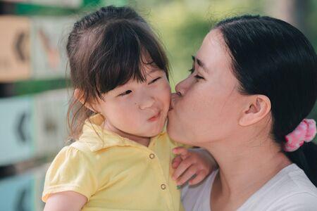 Photo pour Mother kisses daughter - image libre de droit