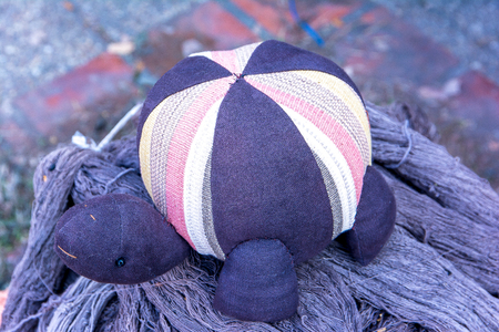 Image of turtle doll made of cloth