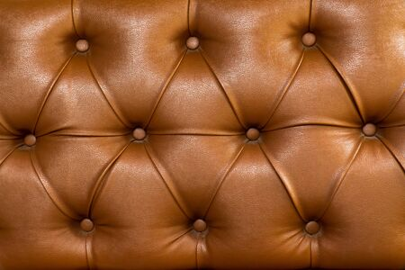 Photo pour Brown leather upholstery chair with buttons pattern background. Dark brown vintage sofa elegant leather with buttons texture surface - image libre de droit