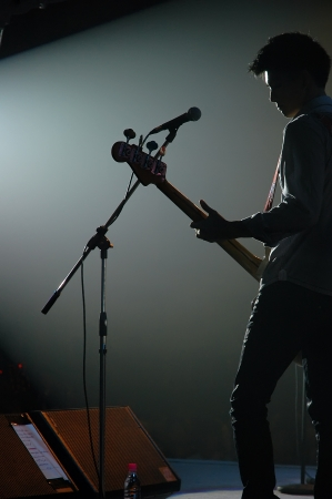 guitarist of a pop band with a guitar
