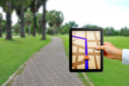 Male hand holding a touchpad gps