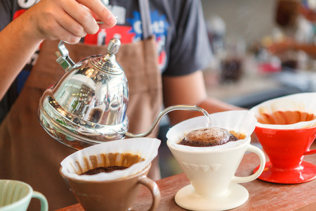 Photo pour Hand drip coffee, Barista pouring water on coffee ground with filter. - image libre de droit