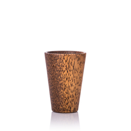 Brown coffee cup made from palm wood. Studio shot isolated on white background