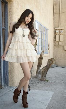 Beautiful model wearing little summer dress