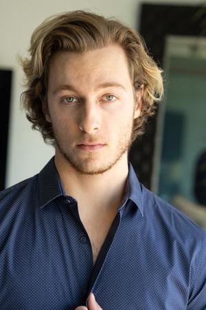 Photo pour Handsome young man blonde hair and stubble wearing shirt - image libre de droit