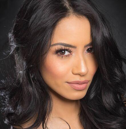 Photo pour Beautiful young woman's face with gorgeous curly black hai - image libre de droit