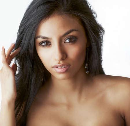 Photo pour Beautiful woman's face with long dark hair. - image libre de droit