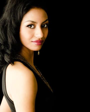 Photo pour Elegant beautiful young woman wearing black dress - image libre de droit