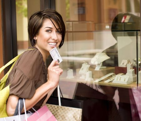 Happy woman shopping with her credit card