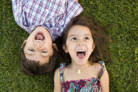 Brother and sister playing outside