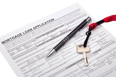 House key with mortgage loan application
