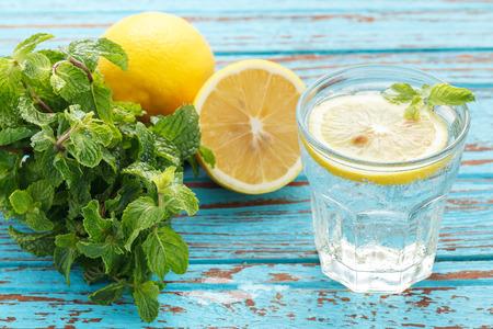 lemon soda mint fresh drink summer refreshment still life blue background wood teak