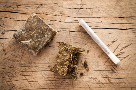 weed marijuana hashish roll wood background herb health medicine alternative