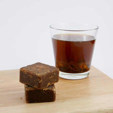 The Taiwan brown sugar ginger tea cubes on the wooden board.