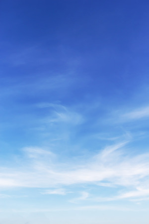 Foto de white clouds and blue sky background - Imagen libre de derechos