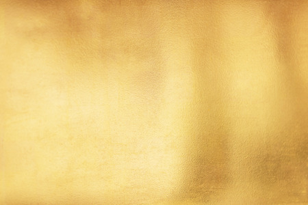 Foto de Gold abstract background or texture and gradients shadow. - Imagen libre de derechos