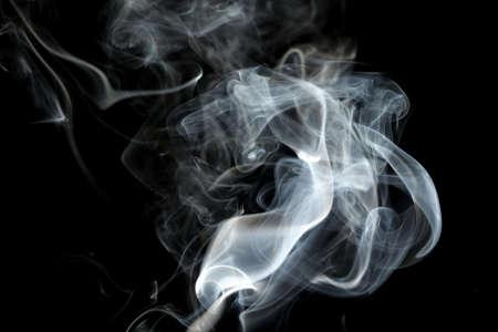 Foto de Smoke or steam on a black background, Abstract - Imagen libre de derechos