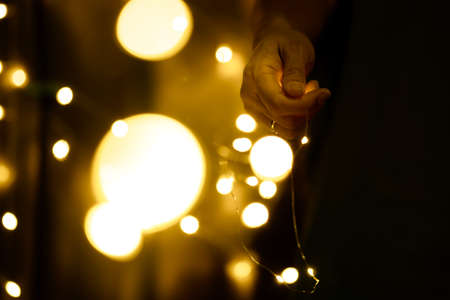 Photo pour Christmas and Happy New Year decorations lighting in the hands of young women - image libre de droit