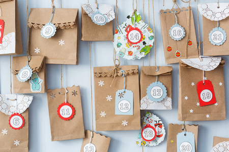 Photo for advent calendar with small gifts close up. - Royalty Free Image