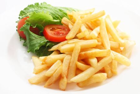 Photo pour A Portion Of Chips With Salad - image libre de droit
