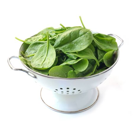 Photo pour Spinach Leaves In A Colander Isolated On White - image libre de droit