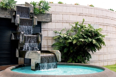 Modern art man made waterfall and pool